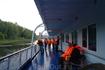 Первое чем мы занялись на корабле -это изучение техники безопасности , одевали спасательные жилеты и потом учебная тревога .
