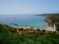 Панорамный вид - с уровня площадки   отеля на пляж и природный парк Каво Греко