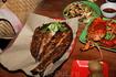 На двоих ужин : Рыба 1 кг, крабы 2 шт, кальмары 0,8 кг, 4 салата, гарнир, пиво - 20долларов ;)