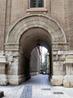 Возможно на это месте были ворота для въезда в монастырь, а сейчас это просто проход во дворы.