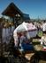 Кубанская девушка торгует сувенирами. Солнце было жаркое, а зонтик у девушки очень оригинальный)))