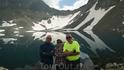 Сзади нас ледник,который отражением спадает в озеро и образует изображение огромной бабочки