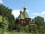 Деревянная церковь во имя Трех Святителей  утопает в зелени