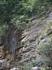 скалы по которым сочится  вода , падая, разбивалась на миллионы радужных капель