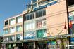 Торговый центр Нха Транг 30 шагов от отеля с права.