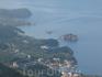 Вдалеке внизу виднеется самый знаменитый остров Черногории - Святого Стефана