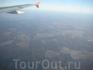 Под крылом самолета о чем то поет, бесконечное море Москвы.