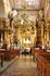 Внутри костела заслуживает внимания живопись и 17 пышно оформленных алтарей.