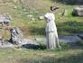 Раскопки святилища Деметры. Копия статуи богини