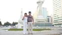 Мы с мужем на фоне трех  символов Эмиратов.