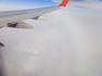 Вторая интересная фотография, сделанная в полете - это появление гало (оптическое явление - круговая радуга) под крылом самолета и отражение в нем этого ...