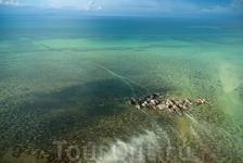 Деревня на сваях в Tongkil, Самальские острова (Samales Islands), Филиппины