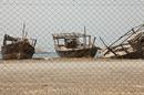 Заброшенные рыболовецкие лодки около порта Диббы