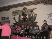 В театральном зале. Наша группа сидела у другой стены.