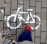 в городе много велосипедов и стоянок для них