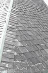 Не удалось выяснить материал покрытия крыши, похоже на шифер?